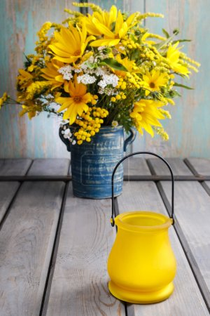 Photo for Bouquet of sunflowers and wild flowers on wooden table. Autumn decoration - Royalty Free Image