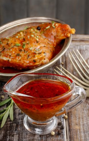 Honey and pepper red marinade in glass gravy boat