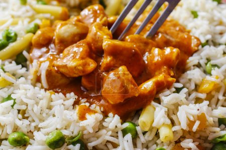 Photo for Chicken curry with basmati rice and green peas, dish popular in India. - Royalty Free Image