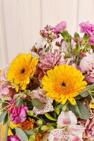 Photo for Bouquet of yellow gerbera daisies and pink carnations. Party decoration - Royalty Free Image