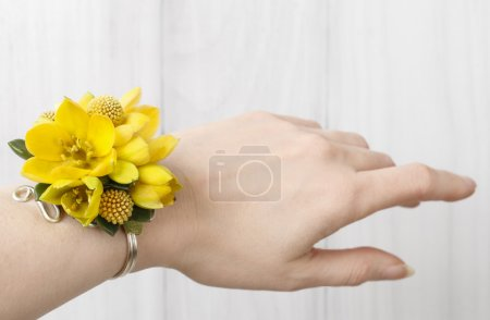 Wrist corsage made of yellow flowers