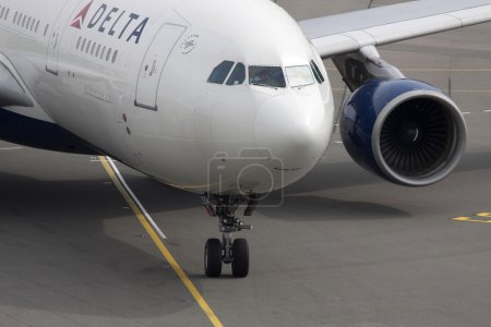 AMSTERDAM, THE NETHERLANDS - 24 AUGUST, 2014: Just arrived Commercial passenger plane from Delta Airlines at Schiphol airport on 24 august, 2014 in Amsterdam, Holland