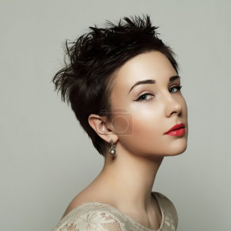 Portrait of a beautiful young girl with short hair. Black and wh