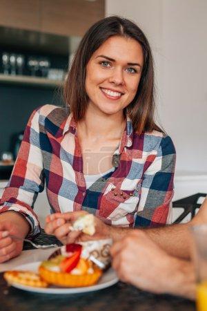 Beautiful young woman eating sweet dessert.