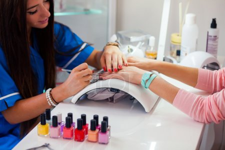Woman on manicure treatment
