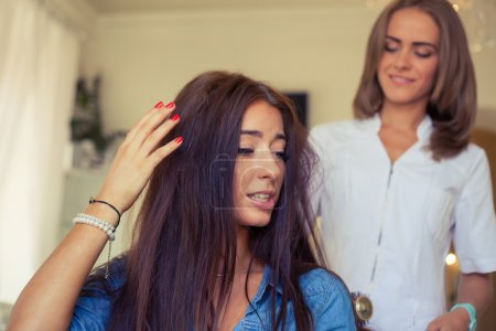 Hairdresser doing haircut for woman