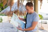 Young tourist  looking at the map.