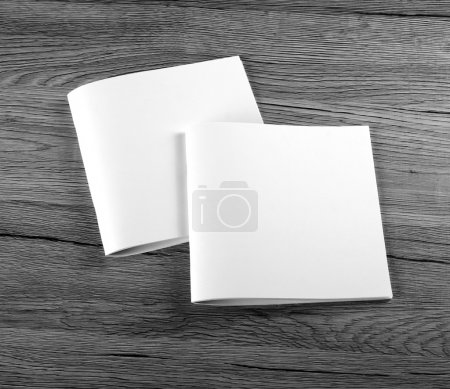 Blank Brochure magazine on wooden background