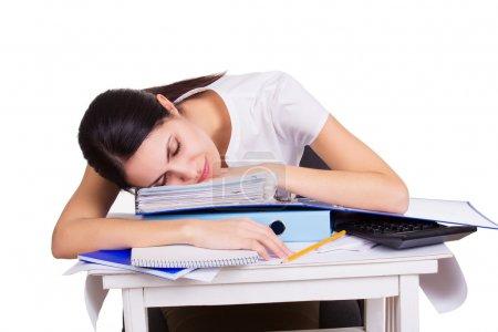 Young business woman sitting stressed in office. People overworked. Headache at work. Tired female sleeping