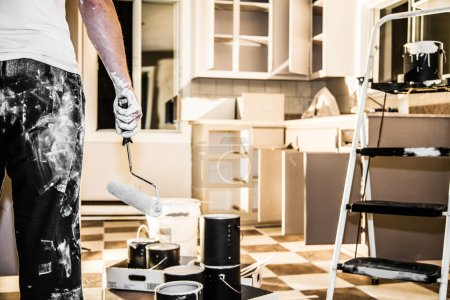 Photo for Mess of All kind of Painting Equipment in the Kitchen and Discouraged Man - Royalty Free Image