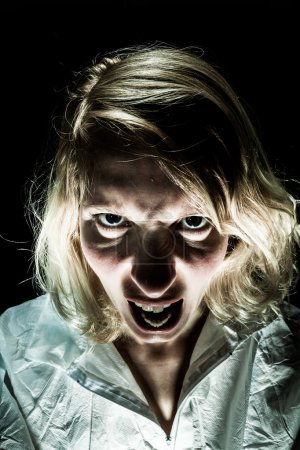 Photo for Insane Psycho Woman Screaming and acting like a Zombie - Royalty Free Image