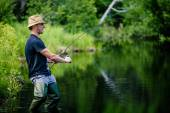 Fisherman Catching a big Fish
