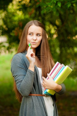 Teen girl with books in hands
