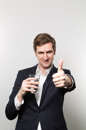 studio shot of businessman with a glas of sparkling water