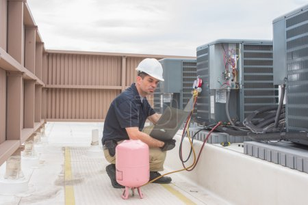 HVAC Technician with panel