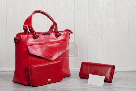 red leather handbag and wallet