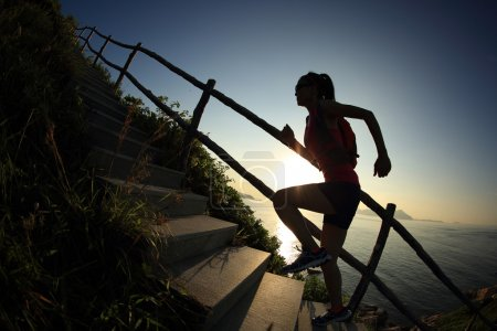 fitness woman on mountain stairs