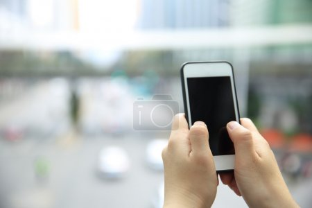 female hands with smart phone