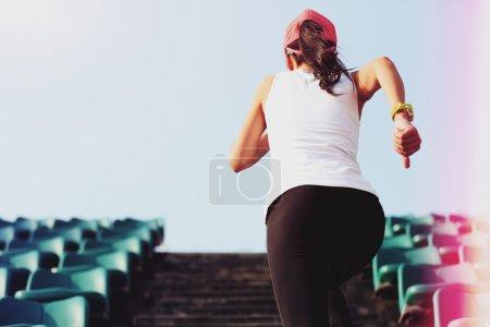 female athlete running on stairs