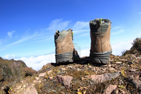 hiking boots on peak