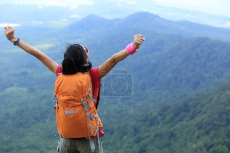 woman hiker with open arms