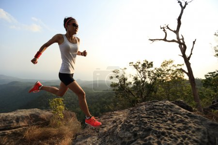 woman runner  on mountain peak