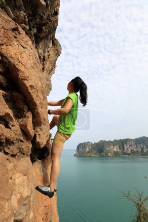 woman rock climber at rock
