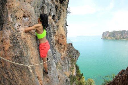 young woman rock climber