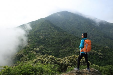 young woman with backpacker
