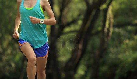 Photo for Young fitness woman runner running in forest - Royalty Free Image