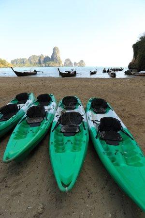 green kayaks on beach