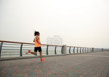 asian woman runner