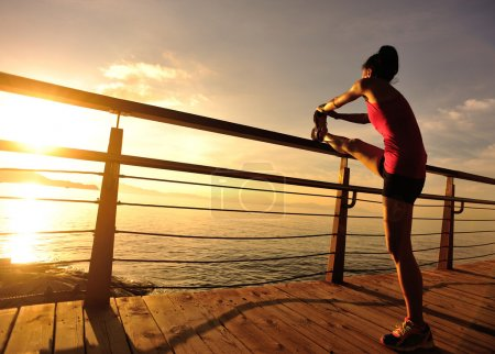 sports woman runner warm up