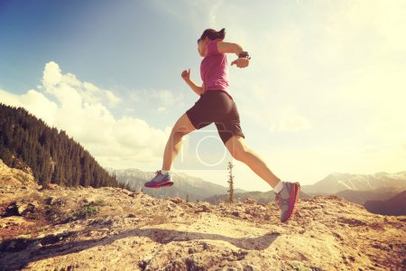 Young woman trail runner running