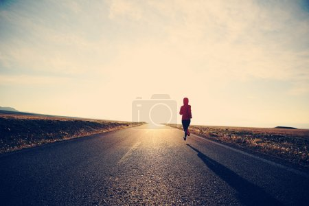 Young fitness woman runner running