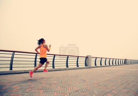 woman running at seaside