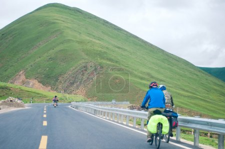 Mountain bike rides on the high mountains of tibet, china