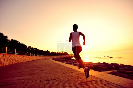 Photo for Runner athlete running at seaside. woman fitness silhouette sunrise jogging workout wellness concept. - Royalty Free Image