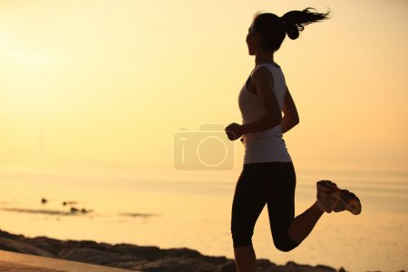 Photo for Runner athlete running at seaside. woman fitness  jogging workout wellness concept. - Royalty Free Image
