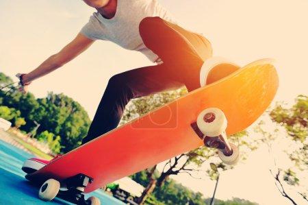 Woman skateboarder at skate park