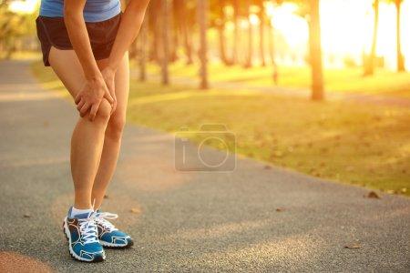 Woman runner  injured leg