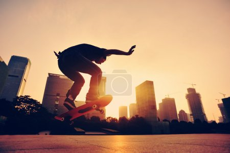 Skateboarder  at sunrise city