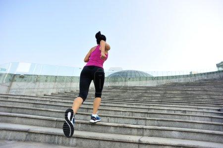 Athlete running on stairs