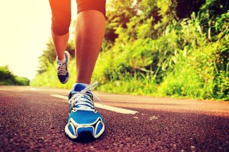 Fitness female legs jogging