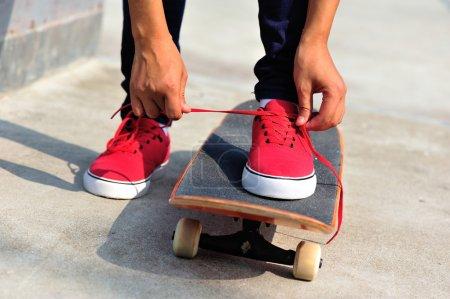 Female with skateboard at skatepark