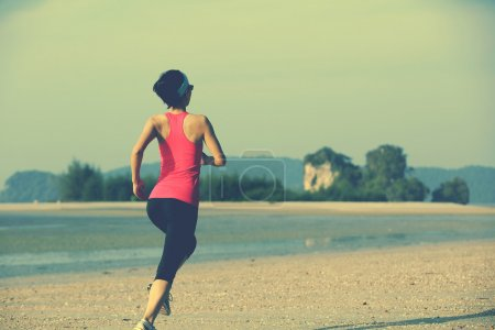 Young fitness woman jogging
