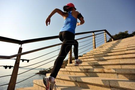 Runner athlete running up stairs