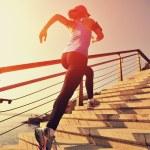 Runner athlete running at seaside up stairs. woman...