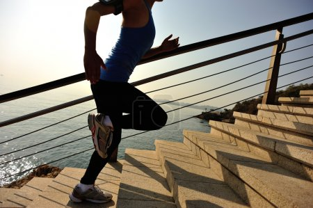 Female Runner athlete running on stairs