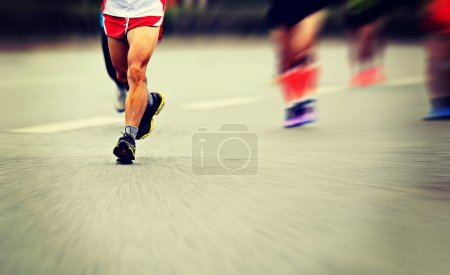 Photo for Male athletes running at marathon - Royalty Free Image